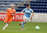 Chicago Red Star forward Megan Rapinoe (8) dribbles away from Sky Blue FC forward Kelly Parker (7).  The Sky Blue FC defeated the Chicago Red Stars 2-0 at Toyota Park in Bridgeview, IL on May 10, 2009.