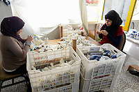 EGYPT, Bilbeis, Sekem organic farm, organic textile production, processing of organic cotton / AEGYPTEN, Bilbeis, Sekem Biofarm, Verarbeitung von Biobaumwolle zu Textilien und Baby Plüschtiere fuer Alnatura