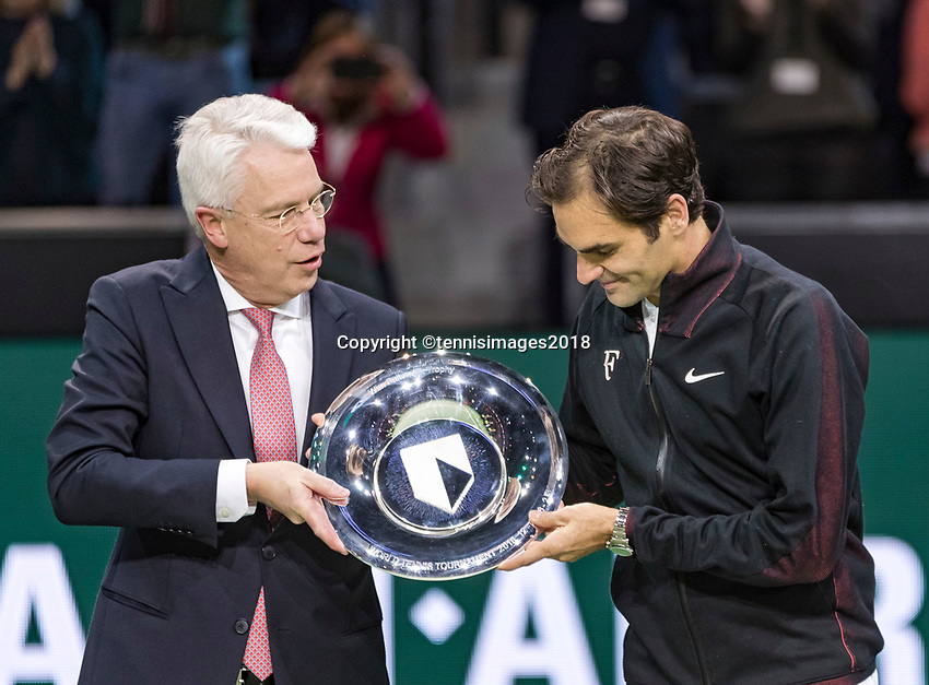 Rotterdam, The Netherlands, 18 Februari, 2018, ABNAMRO World Tennis Tournament, Ahoy, Singles final, Winner of the 45th ABNAMROWTT  Roger Federer (SUI) gets the trophy handed over from  the CEO of the ABNAMRO Bank Kees van Dijkhuizen, <br /> Photo: www.tennisimages.com/henkkoster