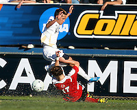 Anthony Ampaipaitakwong #10 of the University of Akron has the ball taked away by a sliding tackle from Brock Granger #17 of the University of Louisville during the 2010 College Cup final at Harder Stadium, on December 12 2010, in Santa Barbara, California.Akron champions, 1-0.