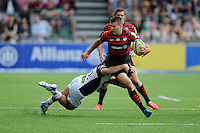 Richard Wigglesworth of Saracens is tackled by Jordan Turner-Hall of Harlequins during the Aviva Premiership semi final match between Saracens and Harlequins at Allianz Park on Saturday 17th May 2014 (Photo by Rob Munro)