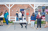 People gather for a Trump campaign office opening party in Salem, New Hampshire, on Fri., Sept. 18, 2020. Former 2016 Trump campaign manager and current 2020 Trump campaign senior advisor Corey Lewandowski, who lives in nearby Windham, NH, attended the party and spoke about the ongoing campaign. It was also Lewandowski's birthday, and the campaign had a cake for him that was decorated to look like a 2020 Trump/Pence campaign sign.