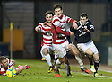 Raith's David Smith is held back by Accies Michael Devlin.