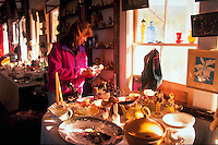 Young woman browsing in antique shop.