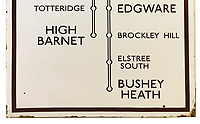 BNPS.co.uk (01202) 558833. <br /> Pic: CatherineSouthonAuctioneers/BNPS<br /> <br /> Pictured: The 1930s London Underground enamel direction sign from East Finchley station complete with the unrealised extension to Bushey Heath station. <br /> <br /> Two rare London Underground signs for a branch of the Northern Line that was never built have emerged for sale more than 80 years later.<br /> <br /> Work had started on the Bushey Heath extension in 1939 but was suspended due to the outbreak of the Second World War and the land was used for farming vegetables instead,<br /> <br /> Despite the fact it never got beyond groundworks and tunnelling, signs were made detailing the new extension stations.<br /> <br /> Two signs which list the three stations planned for the extension - Brockley Hill, Elstree South and Bushey Heath - have now emerged for sale from a large single owner railway collection and are expected to fetch £2,100.