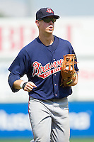 Gwinnett Braves center fielder Todd Cunningham (9) jogs off the field between innings of the International League game against the Charlotte Knights at Knights Stadium on July 28, 2013 in Fort Mill, South Carolina.  The Knights defeated the Braves 6-1.  (Brian Westerholt/Four Seam Images)