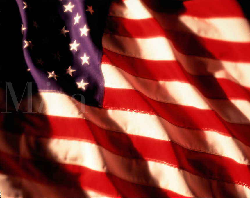 Close-up of American flag blowing in the wind. Americana