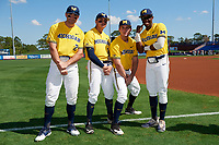Michigan Wolverines Jonathan Engelmann (2), Hector Gutierrez (24), Matthew Schmidt (9), and Christan Bullock (5) jokingly pose for a photo before a game against Army West Point on February 17, 2018 at Tradition Field in St. Lucie, Florida.  Army defeated Michigan 4-3.  (Mike Janes/Four Seam Images)