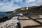 Spain, Canary Islands, La Palma, the southernmost point near Los Canarios Fuencaliente, Punta de Fuencaliente: sea salt production at world biosphere reserve of La Palma - Las Salinas de Fuencaliente, old and new lighthouse Faro de Fuencaliente