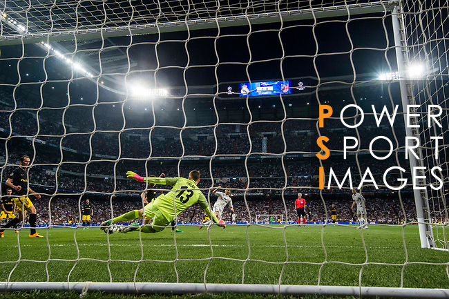 Cristiano Ronaldo of Real Madrid shoots to score the third goal for his team during their 2016-17 UEFA Champions League Semifinals 1st leg match between Real Madrid and Atletico de Madrid at the Estadio Santiago Bernabeu on 02 May 2017 in Madrid, Spain. Photo by Diego Gonzalez Souto / Power Sport Images