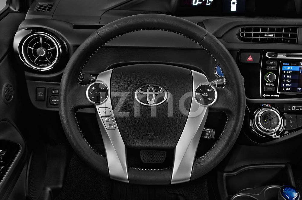 Car pictures of steering wheel view of a 2017 Toyota Prius-c Four 5 Door Hatchback Steering Wheel