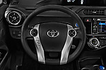 Car pictures of steering wheel view of a 2017 Toyota Prius-c Four 5 Door Hatchback Steering Wheel