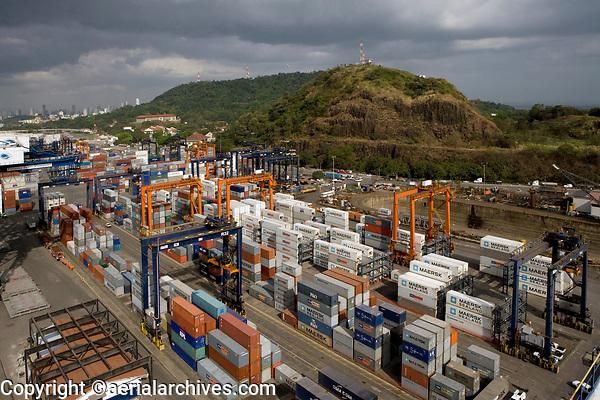 aerial photograph of containers stored at the Port of Balboa, a portion the skyline of Panama City, Panama in the background | fotografía aérea de los contenedores almacenados en el Puerto de Balboa, una porción del horizonte de la Ciudad de Panamá, Panamá al fondo