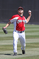Alexander Smit #31 of the Carolina Mudcats throwing in the outfield before a game against the Montgomery Biscuits on April 18, 2010 in Zebulon, NC.