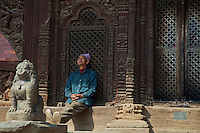 Old man resting in Bhaktapur, Temples and Palace, Nepal,
