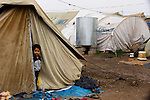 DOMIZ, IRAQ: A young Syrian refugee stands in his tent in the Domiz refugee camp in the Kurdish region of northern Iraq...The semi-autonomous region of Iraqi Kurdistan has accepted around 60,000 refugees from war-torn Syria. Around 20,000 refugees live in the Domiz camp which sits 60 km from the Iraq-Syria border...Photo by Younes Mohammad/Metrography