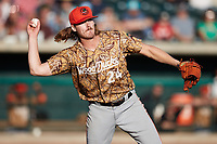 Down East Wood Ducks starting pitcher Mason Englert (24) makes a throw to first base against the Charleston RiverDogs at Joseph P. Riley, Jr. Park on September 26, 2021 in Charleston, South Carolina. (Brian Westerholt/Four Seam Images)