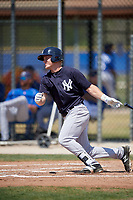 New York Yankees left fielder Trey Amburgey (63) follows through on a swing during a minor league Spring Training game against the Toronto Blue Jays on March 30, 2017 at the Englebert Complex in Dunedin, Florida.  (Mike Janes/Four Seam Images)