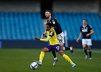 31st October 2020; The Den, Bermondsey, London, England; English Championship Football, Millwall Football Club versus Huddersfield Town; Scott Malone of Millwall challenges Demeaco Duhaney of Huddersfield Town