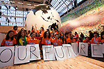 Youth from the British Council hold up signs saying that this is about their future. (Images free for Editorial Web usage for Fresh Air Participants during COP 15. Credit: Robert vanWaarden)