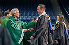 July 10, 2021; 2021 University of Notre Dame president John I Jenkins, C.S.C., hands an ACE medal to a graduate during mass after the Commencement Ceremony of the University of Notre Dame's Alliance for Catholic Education in the Purcell Pavilion. (Photo by Barbara Johnston/University of Notre Dame)