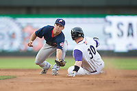 Max Schrock (1) of the Potomac Nationals prepares to apply a tag to Zack Collins (30) of the Winston-Salem Dash as he slides into second base at BB&T Ballpark on July 15, 2016 in Winston-Salem, North Carolina.  The Dash defeated the Nationals 10-4.  (Brian Westerholt/Four Seam Images)