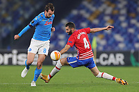 Fabian Ruiz of SSC Napoli and Maxime Gonalons of Granada CF compete for the ball during the Europa League round of 32, 2nd leg football match between SSC Napoli and Granada CF at Diego Armando Maradona stadium in Napoli (Italy), February 25, 2021.<br /> Photo Cesare Purini / Insidefoto