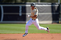 Central Florida Knights infielder Dylan Moore (2) runs the bases during a game against the Siena Saints at Jay Bergman Field on February 16, 2014 in Orlando, Florida.  UCF defeated Siena 9-6.  (Mike Janes/Four Seam Images)