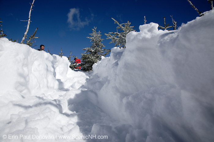 Snowshoe path on the summit of Mount Hancock in the White Mountains, New Hampshire USA during the winter months. The Hancock Loop Trail travels to this summit.