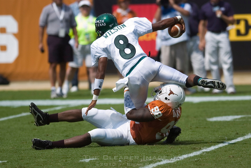 02 September 2006: University of North Texas quarterback Woody Wilson (8) is sacked for a loss by University of Texas defender Brian Orakpo during the Eagles 56-7 loss to the Longhorns at Darrell K Royal Stadium in Austin, TX.