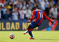11th September 2021; Selhurst Park, Crystal Palace, London, England;  Premier League football, Crystal Palace versus Tottenham Hotspur: Wilfried Zaha of Crystal Palace shoots  to score the 1st goal from a penalty in the 76th minute to make it 1-0