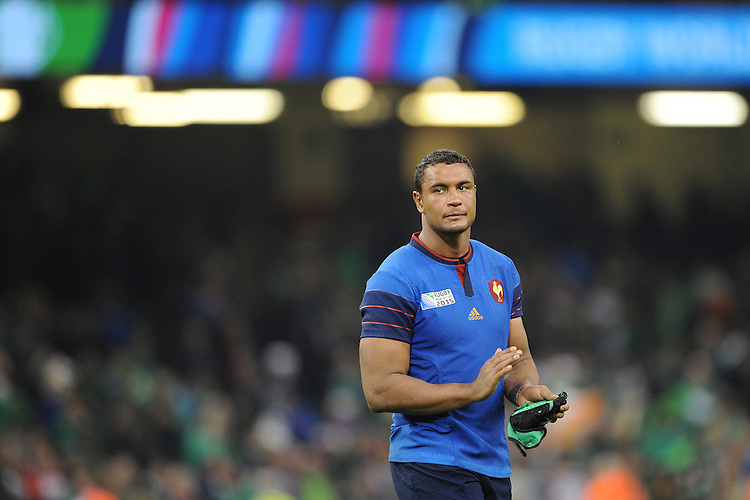 Thierry Dusautoir of France thanks the fans after losing Match 39 of the Rugby World Cup 2015 between France and Ireland - 11/10/2015 - Millennium Stadium, Cardiff<br /> Mandatory Credit: Rob Munro/Stewart Communications