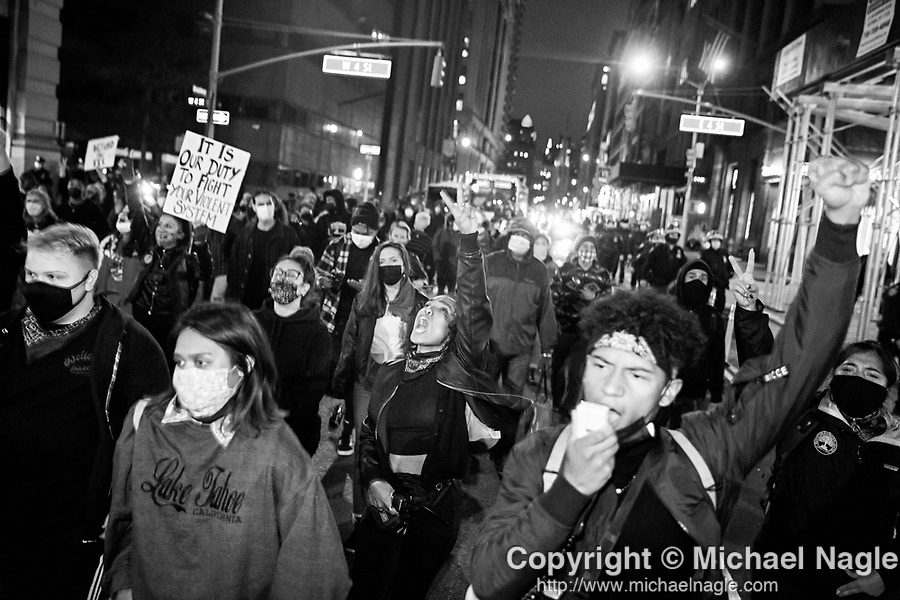 NEW YORK, NY — OCTOBER 27, 2020:  Demonstrators march in a protest against police brutality, in response to the shooting of Walter Wallace Jr. by Philadelphia police officers the prior day, on October 27, 2020 in New York City.  The confrontation, recorded on a now viral video posted to social media, shows Wallace, a 27 year-old Black man who family members said was in the midst of a mental health crisis, holding a knife as two police officers shot and killed him.  Photograph by Michael Nagle