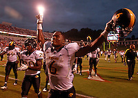 Southern Miss Golden Eagles players celebrate the 30-24 win over the Virginia Cavaliers during the game at Scott Stadium.  (Photo/Andrew Shurtleff)