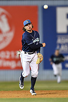 Asheville Tourists shortstop Ryan Vilade (4) throws to first base during a game against the Columbia Fireflies at McCormick Field on April 12, 2018 in Asheville, North Carolina. The Fireflies defeated the Tourists 7-5. (Tony Farlow/Four Seam Images)