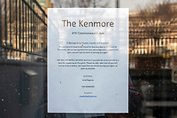 """The Kenmore, a restaurant in Kenmore Square, is temporarily closed due to the ongoing Coronavirus (COVID-19) global pandemic, in Boston, Massachusetts, on Wed., Jan. 6, 2021. A sign on the door states """"We will definitely reopen."""""""