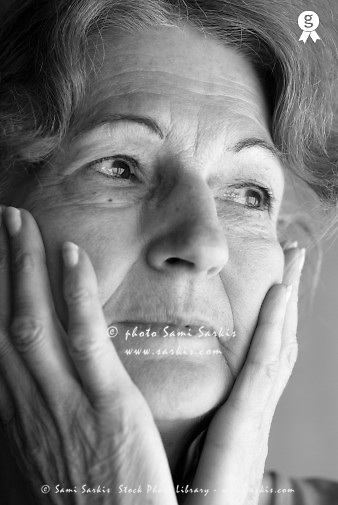 Senior woman with hands on face, close-up (B&W) (Licence this image exclusively with Getty: http://www.gettyimages.com/detail/200503015-001 )