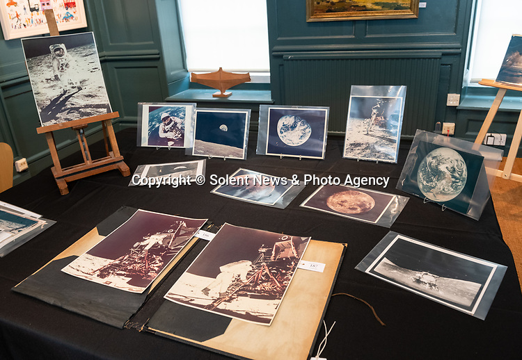 Pictured: Some of the pieces due to be sold in the Space Exploration Photography and Ephemera auction at Dreweatts Auction House in Newbury, Berks today [WEDNESDAY] <br /> <br /> Some of the most historic photographs chronicling the history of man's exploration of space, from early expeditions, to some of the latter trips of the 1990s will be sold at auction.  Over 600 images, many of which capture historic moments, such as the first humans in space, the first spacewalk and the first moon landing will be auctioned today on March 17th 2021 as part of the Space Exploration Photography and Ephemera auction by Dreweatts.<br /> <br /> © Jordan Pettitt/Solent News & Photo Agency<br /> UK +44 (0) 2380 458800