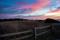 A wooden fence at sunset - Bluff Top Coastal Park, Half Moon Bay, California.