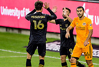 CARSON, CA - OCTOBER 28: Diego Rossi #9 of the Los Angeles FC scores a goal and celebrates with teammate Danny Musovski #16 during a game between Houston Dynamo and Los Angeles FC at Banc of California Stadium on October 28, 2020 in Carson, California.