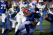 Buffalo Bills running back Chris Ivory (33) is tackled by Trumaine Johnson (22) during an NFL football game against the New York Jets, Sunday, December 9, 2018, in Orchard Park, N.Y.  (Mike Janes Photography)