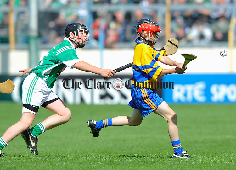 Kevin Hosford of Limerick tackles Colin Burke of Clare  during the Boys Primary game in Thurles. Photograph by John Kelly.