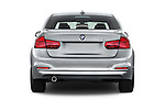 Straight rear view of 2018 BMW 3-Series 320i 4 Door Sedan Rear View  stock images
