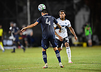LAKE BUENA VISTA, FL - JULY 26: Roberto Puncec of Sporting KC heads the ball during a game between Vancouver Whitecaps and Sporting Kansas City at ESPN Wide World of Sports on July 26, 2020 in Lake Buena Vista, Florida.