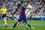 Cristiano Ronaldo of Real Madrid competes for the ball with Sergi Roberto of FC Barcelona during the match of La Liga between Real Madrid and Futbol Club Barcelona at Santiago Bernabeu Stadium  in Madrid, Spain. April 23, 2017. (ALTERPHOTOS)