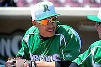 Dayton Dragons third baseman Seth Mejias-Brean #21 in the dugout before a game against the Bowling Green Hot Rods on April 21, 2013 at Fifth Third Field in Dayton, Ohio.  Bowling Green defeated Dayton 7-5.  (Mike Janes/Four Seam Images)