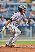 Kannapolis Intimidators shortstop Cleuluis Rondon #5 swings at a pitch during a game against the Asheville Tourists at McCormick Field on June 5, 2014 in Asheville, North Carolina. The Intimidators defeated the Tourists 5-3. (Tony Farlow/Four Seam Images)