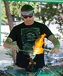 Jason Lennon blowing glass during the inaugural Bud and Brew Music Festival in Wingfield Park in downtown Reno on Saturday, Sept. 23, 2017.