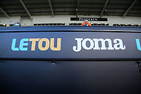 The new black Letou and Joma boards behind the dug out during the Premier League match between Swansea City and Brighton and Hove Albion at The Liberty Stadium, Swansea, Wales, UK. Saturday 04 November 2017
