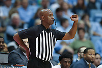 CHAPEL HILL, NC - JANUARY 4: Official Sean Hull calls a foul during a game between Georgia Tech and North Carolina at Dean E. Smith Center on January 4, 2020 in Chapel Hill, North Carolina.
